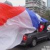 The typical Chilean way to celebrate a victory by roaming around the streets beeping the horn while waving a Chilean flag out the window