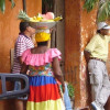 A woman wearing a bowl of fruit on her head in Cartagena, Colombia.