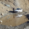 Driving up into the Andes Mountains we came across this water-filled hole blocking our way. A big match for our little car.