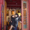 A classic cheesy photo for tourists of doing the tango in the doorway of a shop in La Boca, Argentina